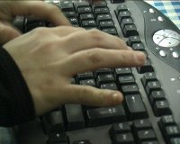 stock-footage-a-particular-of-hands-that-type-on-a-computer-keyboard-pal